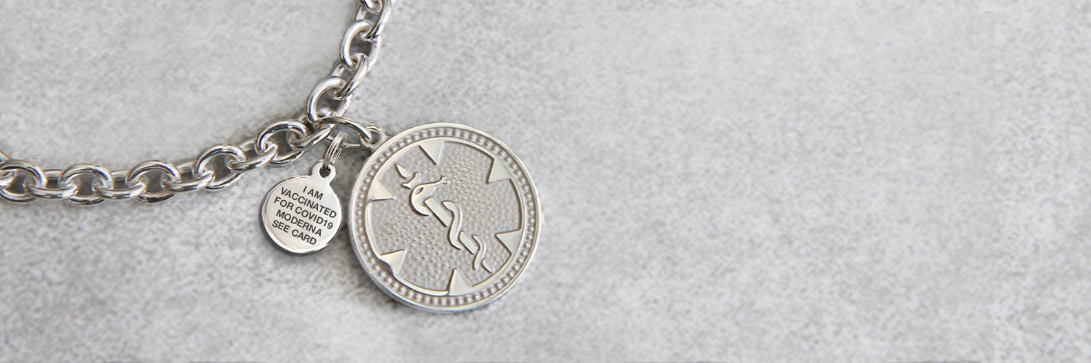 """<span style=""""color:#444444;""""><strong>NEW Vaccine Charms</strong></span><br><span style=""""color: #0c70af;""""><strong> For COVID-19</strong></span>"""